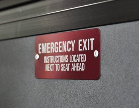 Anodized aluminum transit vehicle emergency exit plate